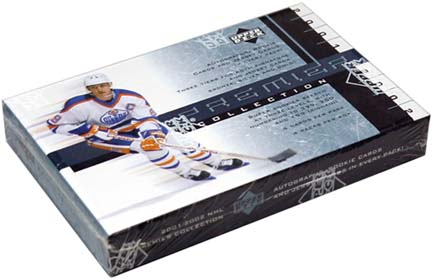 2001-02 Upper Deck Premier (Ultimate) Collection Hockey Pack, ONE numbered Rookie, ONE Game Worn Jersey and ONE Autograph card  front image