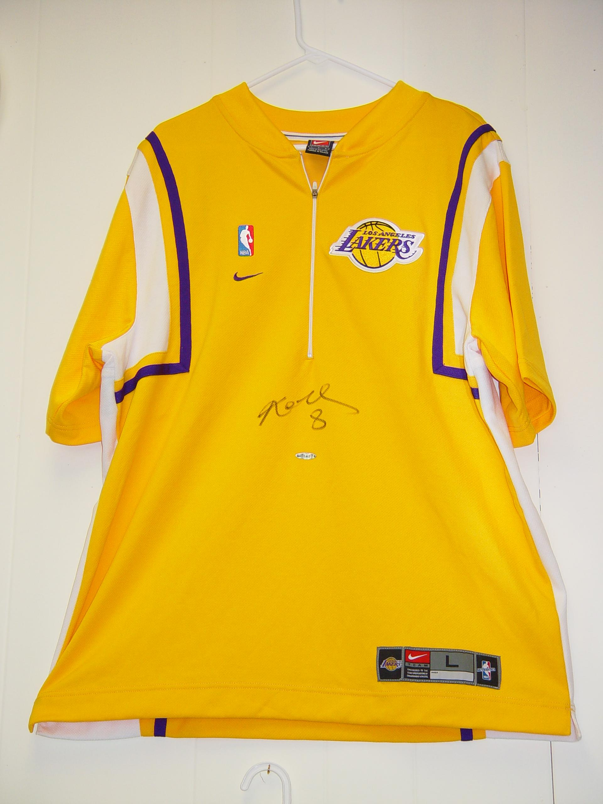 Kobe Bryant Autographed Nike Large Warm-up Jersey from Upper Deck Authenticated!  A Beautiful Piece Featuring a Bold Black Autograph From Kobe!
