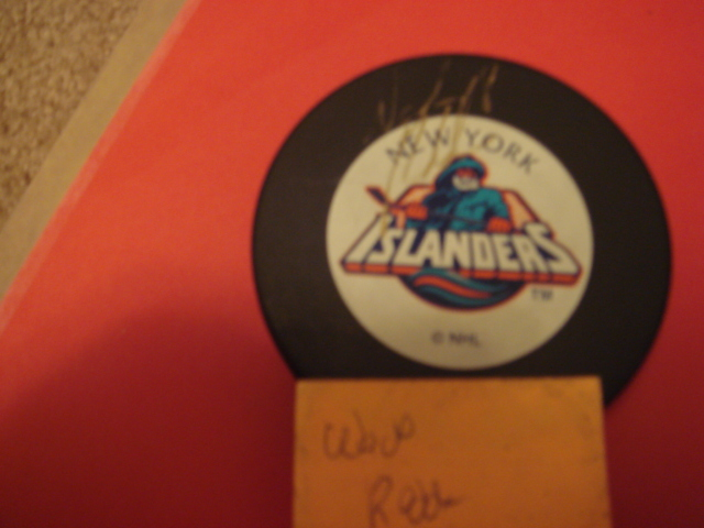 Wade Redden Autographed New York Islanders Fisherman Puck With COA