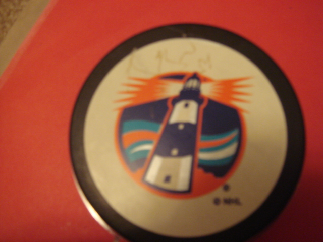 Bryan Berard Autographed Lighthouse Puck with COA