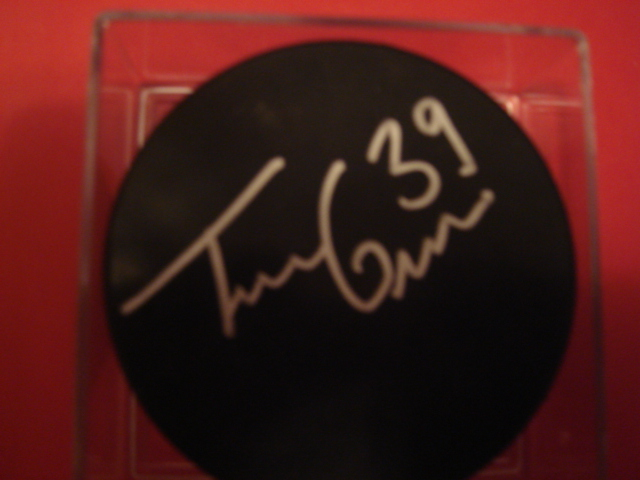 Travis Green  Autographed Blank Puck With COA