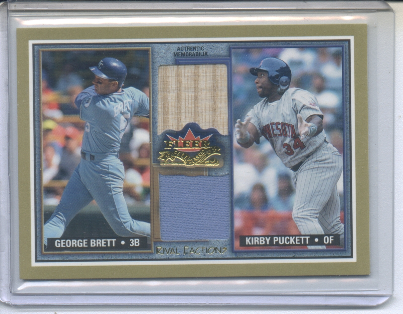 2002 Fleer Fall Classics Rival Factions Game Used Dual #9 George Brett Jsy/Kirby Puckett Bat