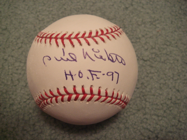 Phil Niekro Autographed Official MLB Baseball With HOF 97 ins. With PSA COA