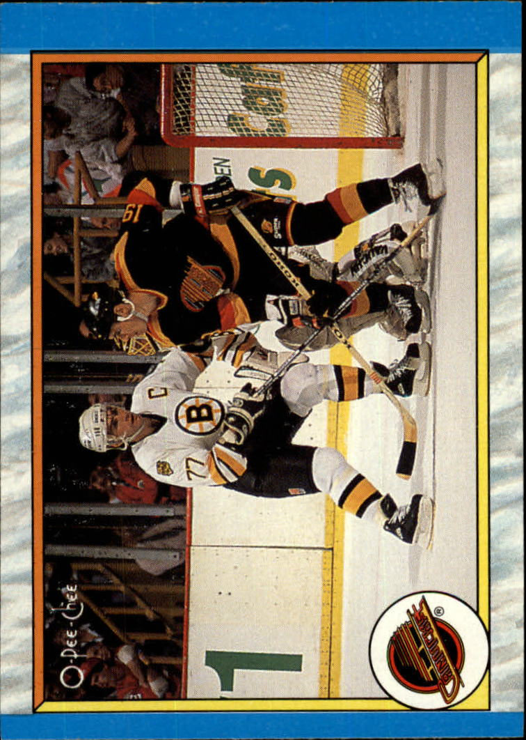 1989-90 O-Pee-Chee #316 Vancouver Canucks/Action Scene/(Jim Sandlak,/Ray Bourque defending)