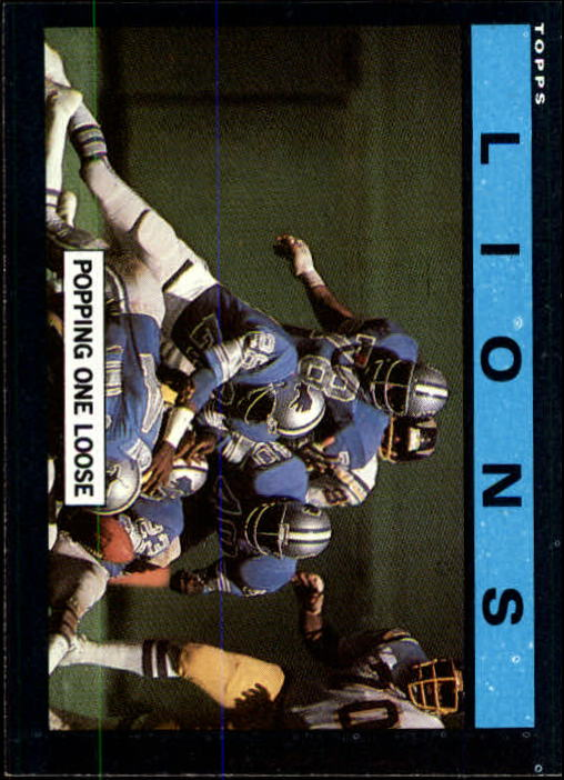 1985 Topps #53 Detroit Lions TL/Popping One Loose/(Lions' Defense)